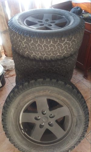 5 Jeep wheels with tires $ 250 obo for Sale in Tampa, FL