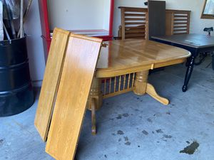 Table honey oak with 2 leaves with 4 chairs . Pick up Dousman or can deliver for $25 more for Sale in Dousman, WI