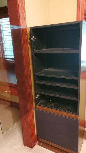 Book shelf multiple shelves hiding place in the bottom for Sale in Canton, OH