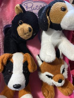 4 Stuffed Puppies With Cute Little Home/carrying Case For Them for Sale in Gresham,  OR