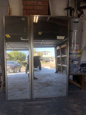 Mirrored closet doors w/tracks and rollers for Sale in Norco, CA