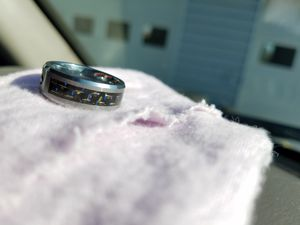 Men's tungsten carbide ring with. 5 blue shapphire for Sale in Sunbury, OH