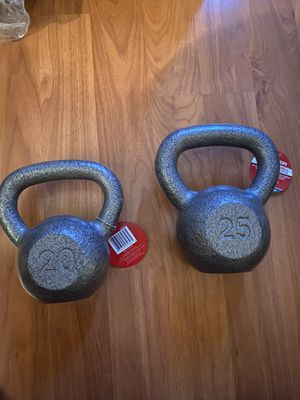 Kettlebells- iron cast 20 pounds and 25 pounds for Sale in Costa Mesa, CA