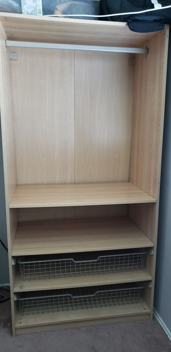 IKEA closet with wire shelves and hanging rod