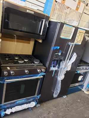 black stainless 3 peace set ,,slide in convention stove..fridge and microwave..top of the line,,kitchen aid,, best item in appliances..only..2999 for Sale in The Bronx, NY