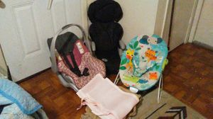 EvenFlo carseat/carrier, EvenFlo booster seat, Kids II hammock and pads for crib. All less than a year old. for Sale in Austin, TX