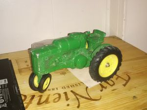 Vintage John Deere iron tractor toy for Sale in Wichita, KS