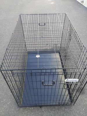 Extra large dog crate cage new condition safe reliable and ready for immediate use double doors and bottom tray pick up or curbside del. is poss. for Sale in Philadelphia, PA