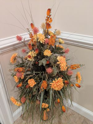 Orange vase with flower arrangement for Sale in Potomac, MD
