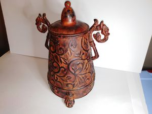 Decorative Metal Lidded Urn with Scroll Pattern Finish for Sale in Fontana, CA