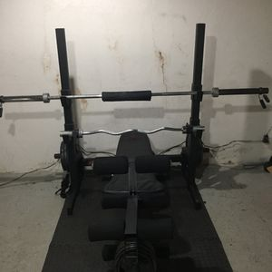 Iron grip gym with weights for Sale in South Plainfield, NJ