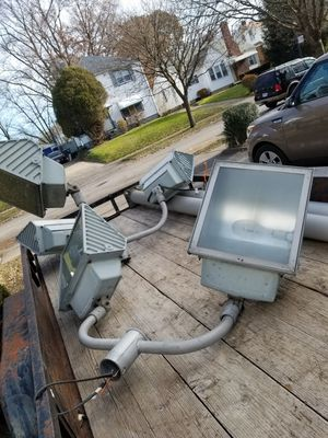 20 feet light poles I have 2 with light Assemblya two head an a 3 for Sale in Cleveland, OH