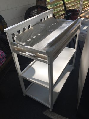 Beautiful white changing table and changing pad for Sale in Tampa, FL