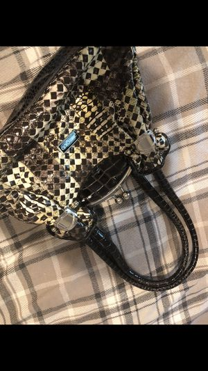 Jimmy choo Handbag. 5 years old. Still in good shape. for Sale in St. Peters, MO