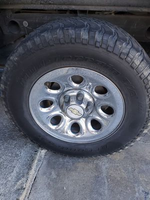 Chevy Silverado stock rims with tires for Sale in Fresno, CA