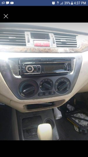 Pop out DVD player radio /CD player come wit remote aux card and blue tooth for Sale in Dallas, TX