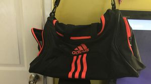 Red and black adidas duffle bag for Sale in Severn, MD