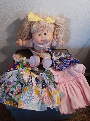 1995 Cabbage Patch Doll with 8 Dresses $25 firm for Sale in El Paso, TX