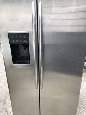 GE profile side by side stainless steel refrigerator with water and ice dispenser for Sale in Federal Way, WA