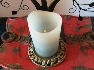 Brass holder and electric candle for Sale in Oklahoma City, OK