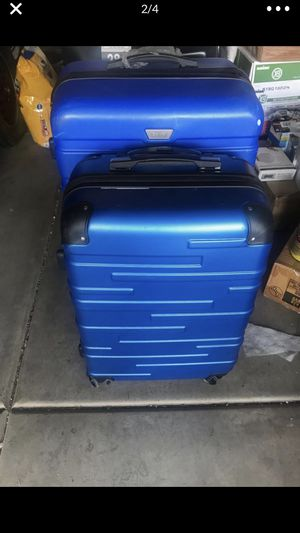 Hard top luggage In assorted colors and sizes comes with a 2 year warranty there light and durable for Sale in Phoenix, AZ
