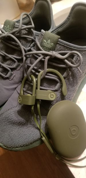 Letting some of my ol gear go today.. Solid Green Adidas Tubulars and matching wireless Powerbeats 3 earbuds. for Sale in San Bernardino, CA