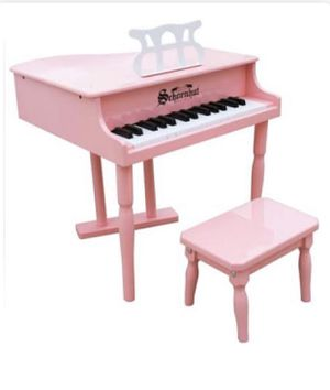 Kids pink baby grand piano and chair for Sale in San Antonio, TX