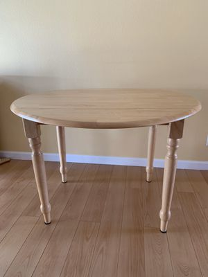42 inch round wooden kitchen table with 4 chairs for Sale in Kirkland, WA