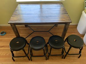 Wooden dining table and 4 black stools for Sale in Oakland, CA