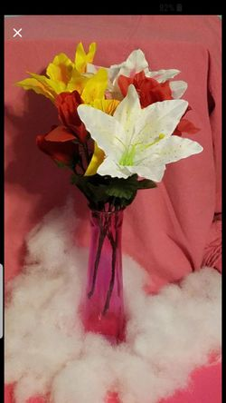 Vase with silk fabric flowers can be used for Birthday, anniversary or any other occasion Please go to my page and see other items that I have listed for Sale in Tucson,  AZ