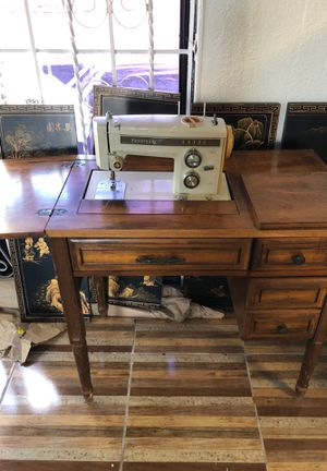 Sewing machine with cabinet for Sale in Pompano Beach, FL
