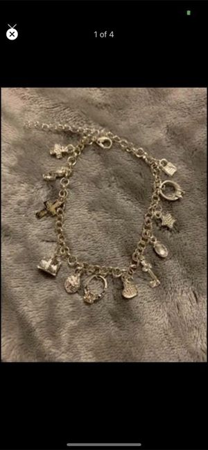 BRAND NEW women's adjustable length bracelet with 12 charms for Sale in West Allis, WI