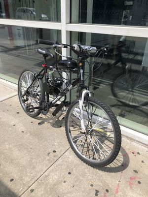 Diamondback bike with a motor on it for Sale in Queens, NY