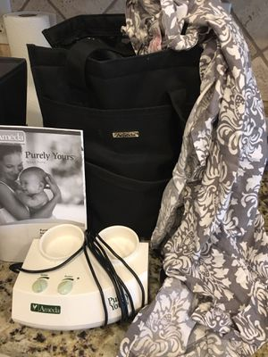 Ameda Breast Pump with bag and cover up for Sale in Litchfield Park, AZ
