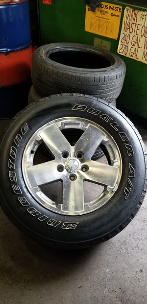 Jeep rims with tire. for Sale in Boston, MA