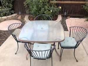 Glass top patio table and chairs. for Sale in Tracy, CA