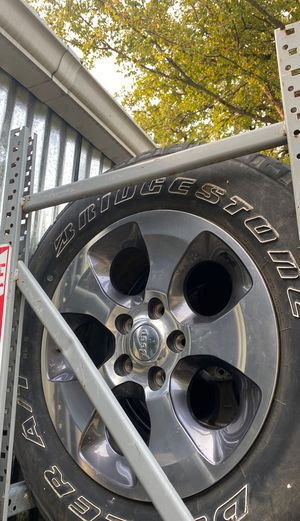 Set of 5 rim and tires Jeep Wrangler oem wheels for Sale in Dallas, TX