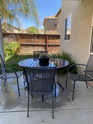 Patio table and chairs with mini fire pit for Sale in Moreno Valley, CA
