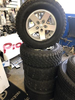 5 OEM wheels and tires for jeep for Sale in Fairfax, VA