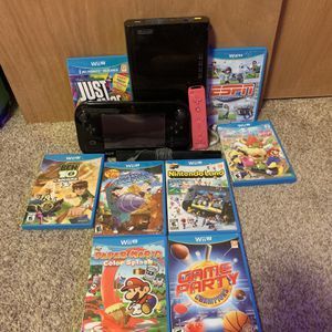 2016 black wii u with antena, pink wii controller, and 8 wii u games for Sale in Aurora, CO