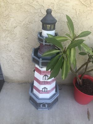 Lighthouse Fountain With small solar panel up top so at night the top turns with lights for Sale in El Cajon, CA
