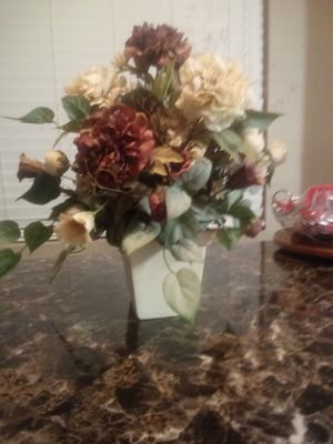 Beautiful artificial flowers in a white ceramic vase for Sale in Las Vegas, NV