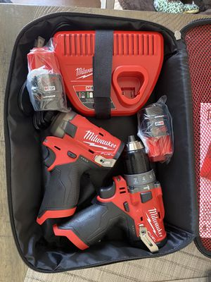 Milwaukee M12 Surge impact & Hammer Drill with two 2.0 batteries and charger for Sale in Lincoln, RI
