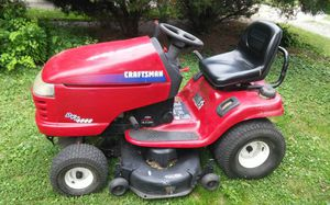 "This is a 2004 DYT 4000 Craftsman Lawn Tractor with a 42""mower deck,leaf and grass collector,seed spreader and trailer. for Sale in Lancaster, OH"