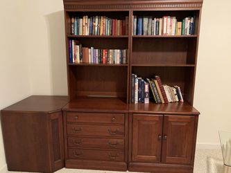 Four piece solid cherry wood desk set in excellent condition. Comes with desk, corner unit and two matching bookcases with filing cabinet. for Sale in Oakton,  VA