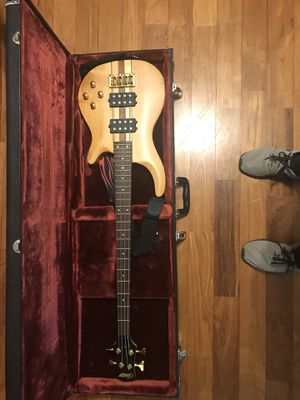 Bass guitar with case and shoulder strap for Sale in Murfreesboro, TN
