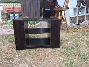 Tv stand / entertainment center for Sale in Denver, CO