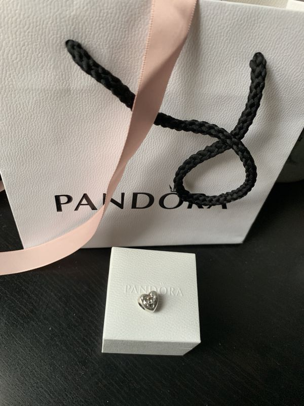 Pandora 14k gold heart of the family charm. Price is reduced and firm!!
