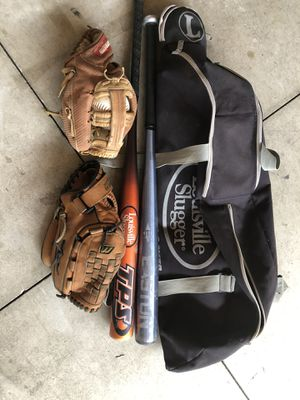 Softball bats and gloves for Sale in Alta Loma, CA