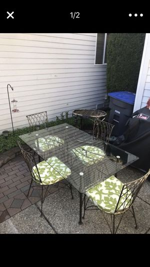 Wrought Iron table and chairs and cushions for Sale in Mukilteo, WA